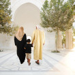Muslim arabic traditional oriental family walking together, beautiful ambient in front of the mosque — Stock Photo