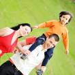 Happy family outdoor, mother father and son, piggy back. — Stock Photo