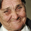 Stock Photo: Closeup portrait of elderly happy womsmiling