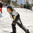 Kid walking on snow, his boot is in wrong direction — Stock Photo #21489875