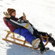Stock Photo: Brother and sister sledding down the hill, snow, winter, happiness and togetherness