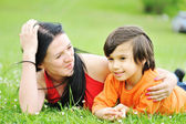 Mother and son on meadow — Stock Photo