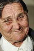 Closeup portrait of elderly happy woman smiling — Stock Photo