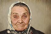 Retrato de uma mulher madura com olhos verdes e um lenço na cabeça — Foto Stock