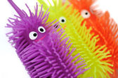 Happy smiling colorful toys — Stock Photo