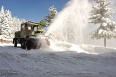 Special winter vehicle for removing snow from road in action — Stock Photo