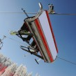 Sky sky lift carrying skiers. — Stock Photo