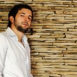 Young fashionable stylish man with a short beard posing — Stock fotografie
