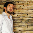 Young fashionable stylish man with a short beard posing — Stock Photo