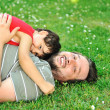 Father and son together on ground — Stock Photo #21495557