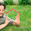 Real estate dreaming concept, man with house in hands — Photo