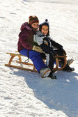 Happy children on snow — Stok fotoğraf