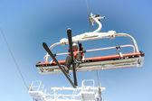Ski lift carrying skiers. — Stock Photo