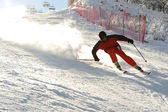 Skiing at ski resort, blured skier in fast motion, extreme sport — Stock Photo