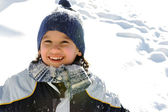 Happy boy on snow — Stock Photo