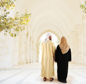 Muslim arabic couple walking together — Stock Photo