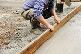 Werken met stucwerk en cement buiten — Stockfoto