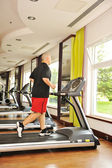 Man jogging indoor, running — Stock Photo