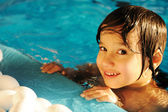 Little happy kid in the pool — Stock Photo