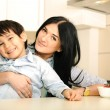 Happy mother and little son in the kitchen, happy time and togetherness — Stock Photo #21501963