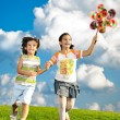 Fantastic scene of happy children running and playing carefreely — Stock Photo