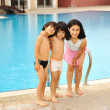 Happy children in pool — Stock Photo