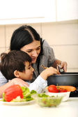 Happy mother and little son in the kitchen, happy time and togetherness — Stock Photo