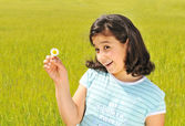 Happy girl with white flower smiling outdoor — Stock Photo