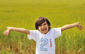 Happy boy with open arms outdoor — Stock Photo