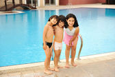 Happy children in pool — Stok fotoğraf