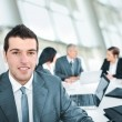 Стоковое фото: Portrait of young businessman in the office
