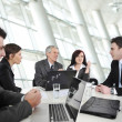 Stock Photo: Businesspeople having business meeting