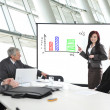 Stock Photo: Business meeting - group of in office at presentation wit