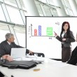 Business meeting - group of in office at presentation wit — Stok fotoğraf