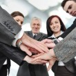 Foto Stock: Group of business with hands together for unity and partn