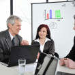 Business meeting - group of in office at presentation — Stock Photo #21530531