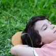 Closeup portrait of a little happy boy sleeping on grass in natu — Stock Photo #21535475