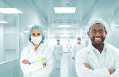 Scientists arabic team at modern hospital lab, group of doctors — Stock Photo