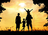 Silhouette, group of happy children playing on meadow, sunset, s — Stock Photo