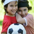 Young boys holding football outside — Stockfoto