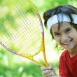 Stock Photo: Kid playing tennis