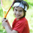 Kid playing tennis - Stockfoto