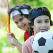 Stock Photo: Young boys with football and tennis outside