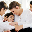 Mother and children at home — Stock Photo