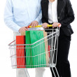 Couple shopping together with cart — Stock Photo #21542115