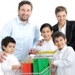 Happy family with a shopping cart — Stock Photo #21542169