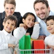 Stock Photo: Happy family with a shopping cart