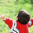 Child outstretched against the sky - Stock Photo