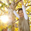 Happy kid in autumn park portrait — Stock Photo #21543033