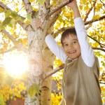Happy kid in autumn park portrait — Stock Photo